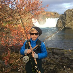 Boy posing with two fly fishing rods in Iceland