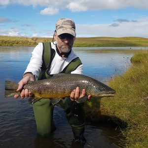 Angler posing with a Sea trout in Iceland