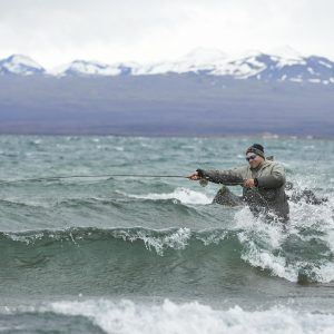 Angler fighting the waves of Lake Thingvellir to catch the large Brown trout the lake holds